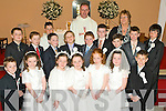 Students from O'Brennan NS who made their First Holy Communion in The Church of the Immaculate Conception, Ballymacelligot on Saturday Afternoon. Pictured were Tadhg Brick, Tiernan Brosnan, Kieran Coggins, Philip Corkery, Cathal Dunne, Cillian Gallagher, Rachel Godley, Kaylin Griffin, Daire Keane, James McDonnell, Michaela Murphy, Tara Murphy, Joshua O'Keefe, Eric O'Sullivan, Thomas Walsh and Claudia Ward with Celebrant Fr Pat Crean-Lynch, Teacher Kathleen Griffin and Alter Boy Shane Godley.Spellings Correct.