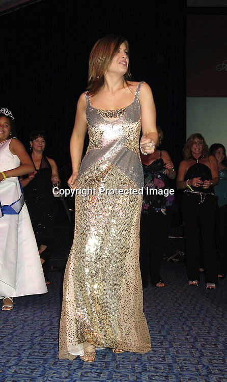 Martha Byrne dancing on stage..at the 11th Annual Daytime Television Salutes St. Jude Children's Research Hospital benefit hosted by Martha Byrne on October 14, 2005 at The New York Marriott Marquis Hotel. ..Photo by Robin Platzer, Twin Images
