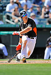 13 March 2012: Miami Marlins outfielder Bryan Petersen gets a base hit during a Spring Training game against the Atlanta Braves at Roger Dean Stadium in Jupiter, Florida. The two teams battled to a 2-2 tie playing 10 innings of Grapefruit League action. Mandatory Credit: Ed Wolfstein Photo