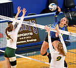 BROOKINGS, SD - OCTOBER 28: Ashlynn Smith #4 from South Dakota State looks to get a kill past McKenzie Burke #5 from North Dakota State during their match Sunday afternoon at Frost Arena in Brookings. (Photo by Dave Eggen/Inertia)