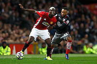 Manchester United's Paul Pogba and Southampton's Nathan Redmond<br /> Manchester 19-08-2016<br /> Premier League,<br /> Manchester United - Southampton <br /> Foto Jason Cairnduff/Panoramic/Insidefoto
