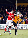 Dean Keates of Wrexham challenges for a header with Paul Carden of Cambridge United during the Blue Square Bet Premier match between Cambridge United and Wrexham at the Abbey Stadium, Cambridge on 22nd January, 2011 .© Kevin Coleman 2011