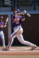 Catcher Doug Hogan (30) of the Clemson Tigers follows through on his swing versus the Wake Forest Demon Deacons during the second game of a double header at Gene Hooks Stadium in Winston-Salem, NC, Sunday, March 9, 2008.