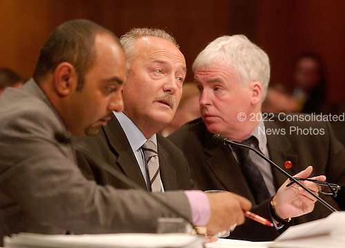 """Washington, D.C. - May 17, 2005 -- George Galloway , Member of Parliament for Bethnal Green and Bow , Great Britain, testifies before the United States Senate Committee on Homeland Security and Governmental Affairs Permanent Subcommittee on Investigations hearing on """"Oil For Influence: How Saddam Used Oil to Reward Politicians Under the United Nations Oil-for-Food Program"""" in Washington, D.C. on May 17, 2005.  From left to right: Asad Rehman, Parliamentary Assistant; Galloway; and Ron McKay, a """"friend""""..Credit: Ron Sachs / CNP"""