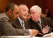 "Washington, D.C. - May 17, 2005 -- George Galloway , Member of Parliament for Bethnal Green and Bow , Great Britain, testifies before the United States Senate Committee on Homeland Security and Governmental Affairs Permanent Subcommittee on Investigations hearing on ""Oil For Influence: How Saddam Used Oil to Reward Politicians Under the United Nations Oil-for-Food Program"" in Washington, D.C. on May 17, 2005.  From left to right: Asad Rehman, Parliamentary Assistant; Galloway; and Ron McKay, a ""friend""..Credit: Ron Sachs / CNP"