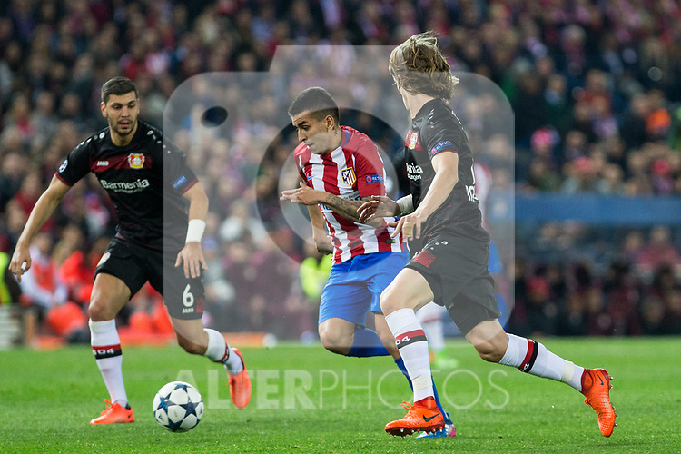 Angel Correa of Atletico de Madrid competes for the ball with  Aleksandar Dragovic, Tin Jedvaj of Bayer 04 Leverkusen during the match of Uefa Champions League between Atletico de Madrid and Bayer Leverkusen at Vicente Calderon Stadium  in Madrid, Spain. March 15, 2017. (ALTERPHOTOS / Rodrigo Jimenez)
