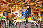Ben and Maria Brosnan Currow enjoying a ride on the Carousel at the Christmas in Killarney winter wonderland at the Old Milk Market Lane on Sunday..