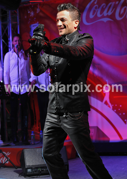 **ALL ROUND PICTURES FROM SOLARPIX.COM**.**WORLDWIDE SYNDICATION RIGHTS**.Peter Andre playing live at Spitalfields Market in the City of London tonight..This pic:    Peter Andre.JOB REF:  10417   SSD     DATE:   17.12.09.**MUST CREDIT SOLARPIX.COM OR DOUBLE FEE WILL BE CHARGED**.**MUST NOTIFY SOLARPIX OF ONLINE USAGE**.**CALL US ON: +34 952 811 768 or LOW RATE FROM UK 0844 617 7637**