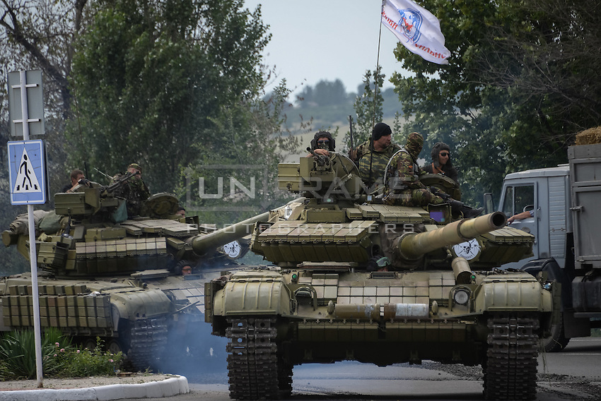Pro-Russian rebels on top of tanks in the city of Snizhne, Ukraine.
