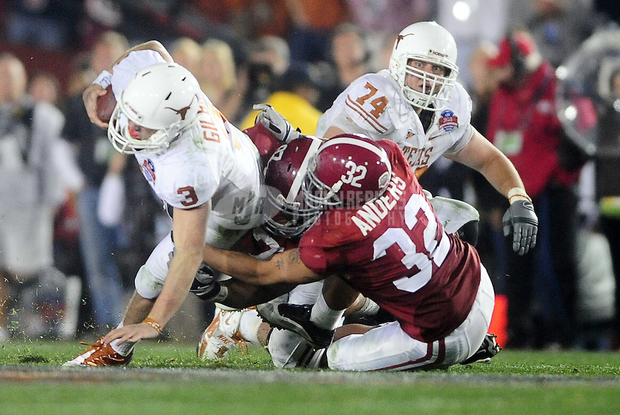 Jan 7, 2010; Pasadena, CA, USA; Texas Longhorns quarterback Garrett Gilbert (3) is tackled by Alabama Crimson Tide linebacker Eryk Anders (32) during the fourth quarter of the 2010 BCS national championship game at the Rose Bowl.  Mandatory Credit: Mark J. Rebilas-