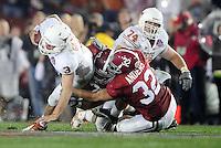 Jan 7, 2010; Pasadena, CA, USA; Texas Longhorns quarterback Garrett Gilbert (3) is tackled by Alabama Crimson Tide linebacker Eryk Anders (32) during the fourth quarter of the 2010 BCS national championship game at the Rose Bowl.  Mandatory Credit: Mark J. Rebilas-