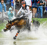 LEXINGTON, KENTUCKY - APRIL 29: Vermiculus #33, with rider Lauren Kieffer (USA), take a hard landing but escape at the Head of the Lake during the Cross Country Test at the Rolex Kentucky 3-Day Event at the Kentucky Horse Park on April 29, 2017 in Lexington, Kentucky. (Photo by Scott Serio/Eclipse Sportswire/Getty Images)