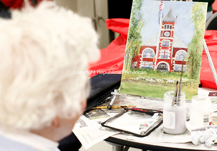 Naugatuck, CT- 05 January 2015-010515CM01-  Mary Lou Bermeister of Naugatuck, looks at her painting which depicts Thompson Hall at the University of New Hampshire, during an art class at the Naugatuck Senior Center on Monday.   Christopher Massa Republican-American