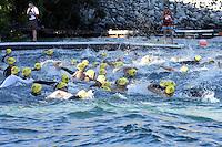 A wave of triathletes begin their swim at the Chelanman Multi-Sport weekend in Chelan.