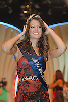 Newly crowned Miss World Hungary Linda Szunai adjusts her crown after winning a joint beauty contest in Budapest, Hungary on July 14, 2011. ATTILA VOLGYI