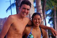 Teens friends laughing & having fun on Waikiki beach