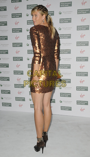 MARIA SHARAPOVA.The WTA Pre-Wimbledon Party, The Roof Gardens, Kensington, London, USA..June 17th, 2010.full length bronze sequined sequin dress sleeves black peep toe ankle strap shoes looking over shoulder .CAP/CAN.©Can Nguyen/Capital Pictures.