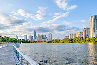 This was an image of the Austin Boardwalk taken during the day time with some nice clouds over the skyline on Lady Bird Lake in this modern city.