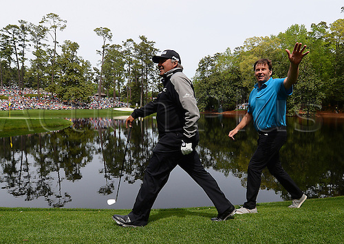 06.04.2016. Augusta, GA, USA. Angel Cabrera, left, and golf analyst Nick Faldo walk to the ninth green during the Par 3 contest on Wednesday, April 6, 2016, at Augusta National Golf Club in Augusta, Ga