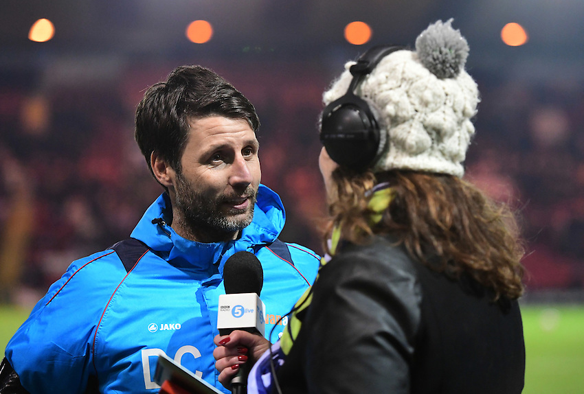Lincoln City manager Danny Cowley is interviewed by BBC Radio 5 Live's Caroline Barker before kick off<br /> <br /> Photographer Chris Vaughan/CameraSport<br /> <br /> Emirates FA Cup Third Round Replay - Lincoln City v Ipswich Town - Tuesday 17th January 2017 - Sincil Bank - Lincoln<br />  <br /> World Copyright &copy; 2017 CameraSport. All rights reserved. 43 Linden Ave. Countesthorpe. Leicester. England. LE8 5PG - Tel: +44 (0) 116 277 4147 - admin@camerasport.com - www.camerasport.com