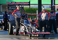 May 18, 2012; Topeka, KS, USA: NHRA crew members for top fuel dragster driver Steve Torrence during qualifying for the Summer Nationals at Heartland Park Topeka. Mandatory Credit: Mark J. Rebilas-