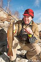 Angler holding a large splake.