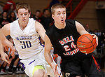 RAPID CITY, S.D. MARCH 20, 2015 -- Ty Hoglund #24 of Dell Rapids drives past Sam Naasz #30 of Winner during their semi-final game at the 2015 South Dakota State A Boys Basketball Tournament at the Don Barnett Arena in Rapid City, S.D.  (Photo by Dick Carlson/Inertia)