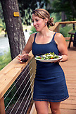 USA, Oregon, Wild and Scenic Rogue River in the Medford District, river guide Taylor Buchannon has dinner at the Paradise Lodge