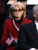 New York, NY - November 11, 2008 -- Barbara Walters, holding as American Flag, looks on as United States President George W. Bush makes remarks on Veteran's Day at the rededication ceremony of the Intrepid Sea, Air and Space Museum in New York City on Tuesday, November 11, 2008.<br /> Credit: John Angelillo - Pool via CNP