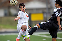 NWA Democrat-Gazette/JASON IVESTER --03/20/2015--<br /> Rogers Heritage junior Osmin Perez (left) and Bentonville sophomore Jose Castro vie for possession during the first half on Friday, March 20, 2015, at David Gates Stadium in Rogers.