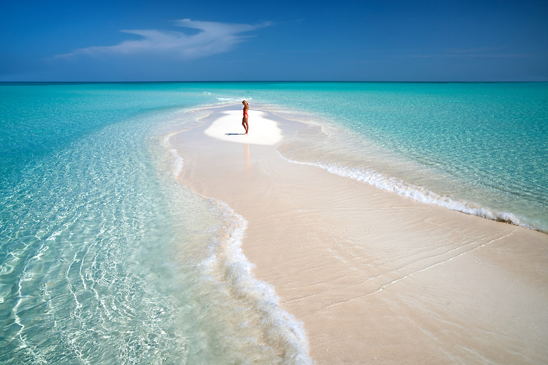 Woman on samll sand island. Turks and Caicos. Providenciales