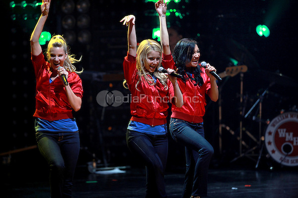 Heather Morris, Dianna Agron and Jenna Ushkowitz performing at the Glee Concert Tour. The Gibson Amphitheatre at Universal City Walk in Los Angeles, California. May 20, 2010.Credit: Dennis Van Tine/MediaPunch
