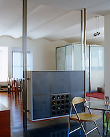 This custom-made cabinet acts as a room divider between the kitchen and living area as well as providing storage for wine