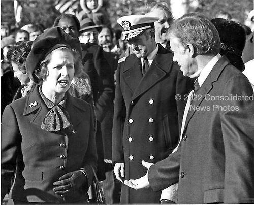 """Prime Minister Margaret Thatcher of the United Kingdom, left, is welcomed to the White House in Washington, D.C. by United States President Jimmy Carter, right, on Monday,December 17, 1979. It was Mrs. Thatcher's first trip to the United States as Prime Minister.  Thatcher died from a stroke at 87 on Monday, April 8, 2013..Credit: Benjamin E. """"Gene"""" Forte - CNP"""