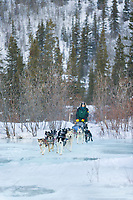 Musher Dave Dalton crosses overflow on Ptarmigan creek near mile 101 checkpoint during the 1000 mile Yukon Quest sled dog race 2006, between Fairbanks, Alaska and Whitehorse, Yukon. Dubbed the toughest dogsled race in the world.