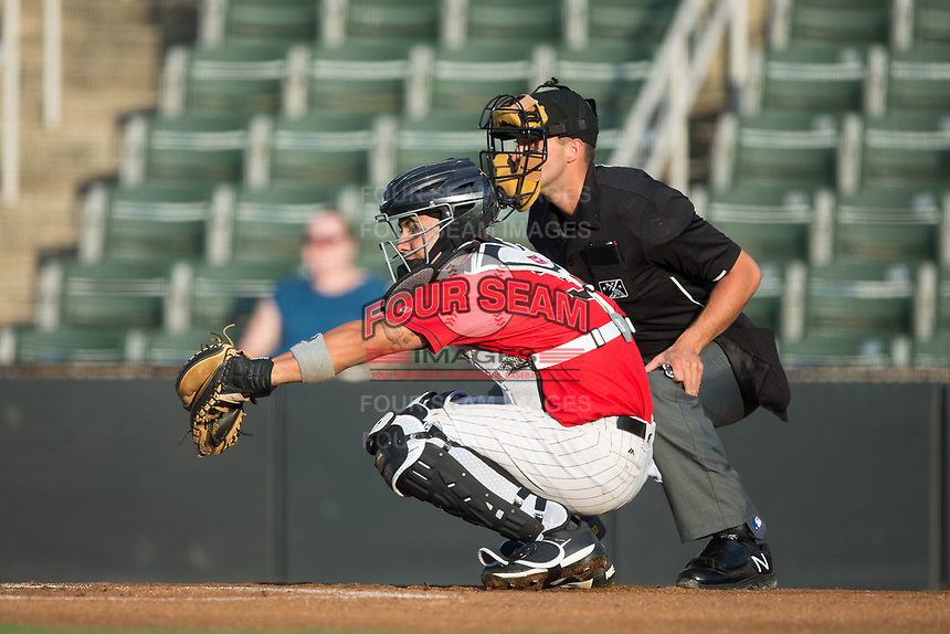 Kannapolis Intimidators catcher Daniel Gonzalez (30) sets a target as home plate umpire Jude Koury looks on during the game against the West Virginia Power at Kannapolis Intimidators Stadium on July 19, 2017 in Kannapolis, North Carolina.  The Power defeated the Intimidators 7-4 in 11 innings.  (Brian Westerholt/Four Seam Images)