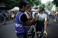 Johan Esteban Chaves (COL/Orica-GreenEDGE) giving some last live columbian interviews straight after the finish<br /> <br /> Giro d'Italia 2015<br /> final stage 21: Torino - Milano (178km)