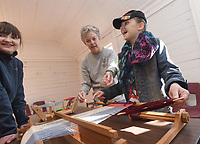 NWA Democrat-Gazette/FLIP PUTTHOFF <br /> EAGER WEAVERS<br /> Marian Servis (left) and her sister, Lilliyanna Servis, 10, try their hand Saturday March 16 2019 at weaving with a loom during a weaving workshop at Shiloh Museum of Ozark History in downtown Springdale. Judy Costello (center) with the museum staff helps the girls. Members of the Northwest Arkansas Handweavers Guild hosted the workshop as part of the museum's Family Fun Day. The guild was founded in 1949 and started the first War Eagle Fair in 1954 with a show of their handiwork, said Laura Redford, guild member.
