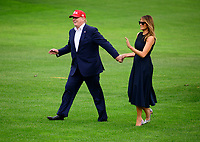 United States President Donald J. Trump and first lady Melania Trump wave to guests as they return to the South Lawn of the White House in Washington, DC from their European trip on Friday, June 7, 2019. Photo Credit: Ron Sachs/CNP/AdMedia