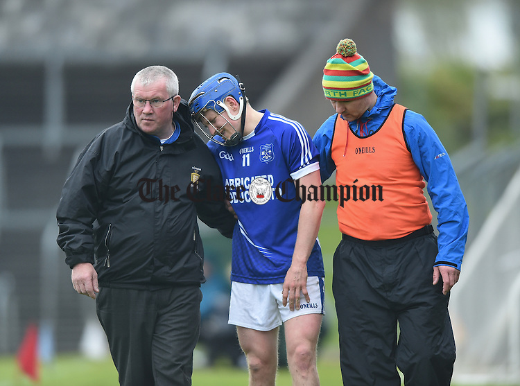 Podge Collins of Cratloe looks to be in serious pain as he is taken off with an injury during their match against Ballyea in Ennis. Photograph by John Kelly.