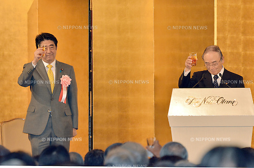January 7, 2014, Tokyo, Japan - Prime Minister Shinzo Abe raises his glass in toast during a new year party co-hosted by Japan's three major business organization at a Tokyo hotel on Tuesday, January 7, 2014. At right is Chairman Akio Mimura of the Japanese Chamber of Commerce and Industry. (Photo by Natsuki Sakai/AFLO)