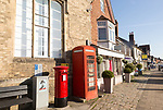 Traditional red phone box and pillar letter box, High Street, Marlborough, Wiltshire, England, UK