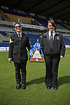 Two security guards holding the Conference National trophy at Field Mill stadium during an open day held for Mansfield Town supporters. Mansfield Town achieved promotion back to England's Football League by winning the Conference National in season 2012-13. Field Mill was the oldest ground in the Football League, hosting football since 1861 although some reports date it back as far as 1850, with Mansfield Town having played there since 1919.