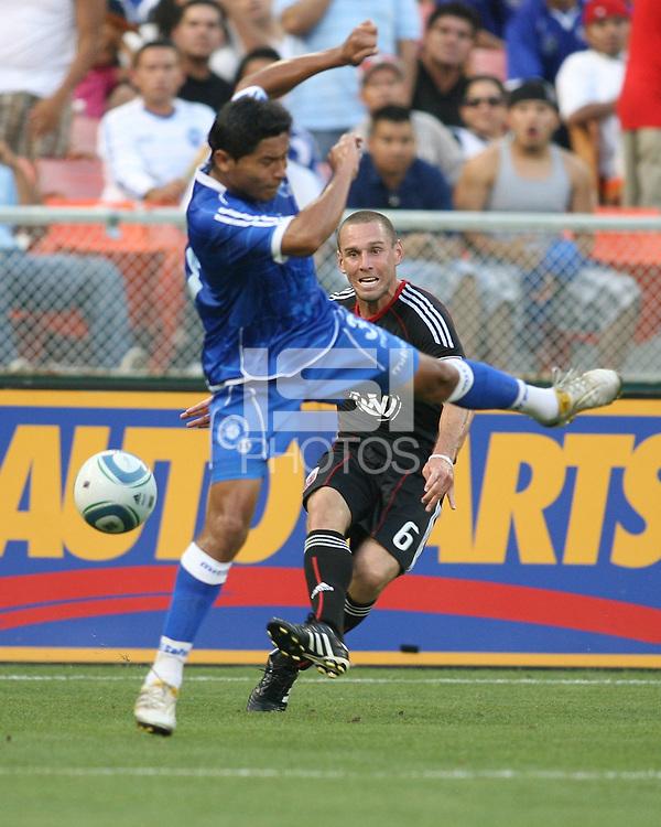 Kurt Morsink #6 of D.C. United fires past Victor Turcios #3  of El Salvador during an international charity match at RFK Stadium, on June 19 2010 in Washington DC. D.C. United won 1-0.