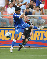 Kurt Morsink #6 of D.C. United fires past Victor Turcios #3  of El Salvador during an international charity match at RFK Stadium, on June 19 2010 in Washington DC. D.C. United won 1-0.