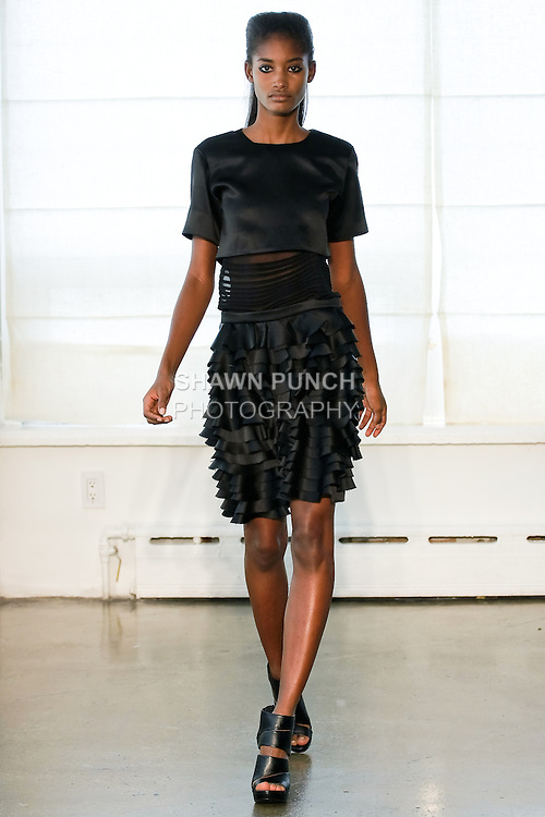 Model walks the runway in an outfit by Graeme Armour for the Graeme Armour Spring Summer 2011 collection, during New York Fashion Week, September 13, 2010.