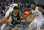 Colorado State's Prentiss Nixon drives past Nevada's Jordan Caroline in the first half of an NCAA college basketball game in Reno, Nev., Sunday, Feb. 25, 2018. (AP Photo/Tom R. Smedes)