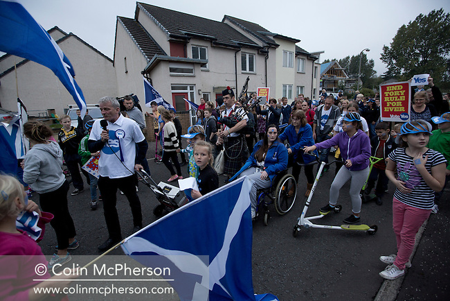 A musician with bagpipes leading a spontaneous march to mobilise support for a pro-independence vote in the Craigmillar district of Edinburgh on the day of the independence referendum. Yes Scotland were campaigning for the country to leave the United Kingdom, whilst Better Together were campaigning for Scotland to remain in the UK. On the 18th of September 2014, the people of Scotland voted in a referendum to decide whether the country's union with England should continue or Scotland should become an independent nation once again and leave the United Kingdom.