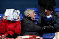 Oldham Athletic's fan hides her face with a match proggramme ahead of the Sky Bet League 1 match between Oldham Athletic and Rotherham United at Boundary Park, Oldham, England on 13 January 2018. Photo by Juel Miah / PRiME Media Images.
