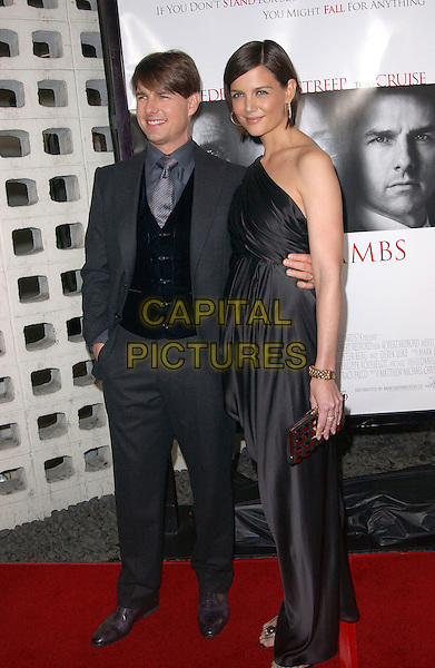 "TOM CRUISE & KATIE HOLMES.""Lions For Lambs"" 2007 AFI Festival Opening Night Gala held at the ArcLight Hollywood Cinemas, Hollywood, California, USA, 01 November, 2007..full length black one shoulder dress married husband wife couple .CAP/ADM/RE.©Russ Elliot/AdMedia/Capital Pictures."